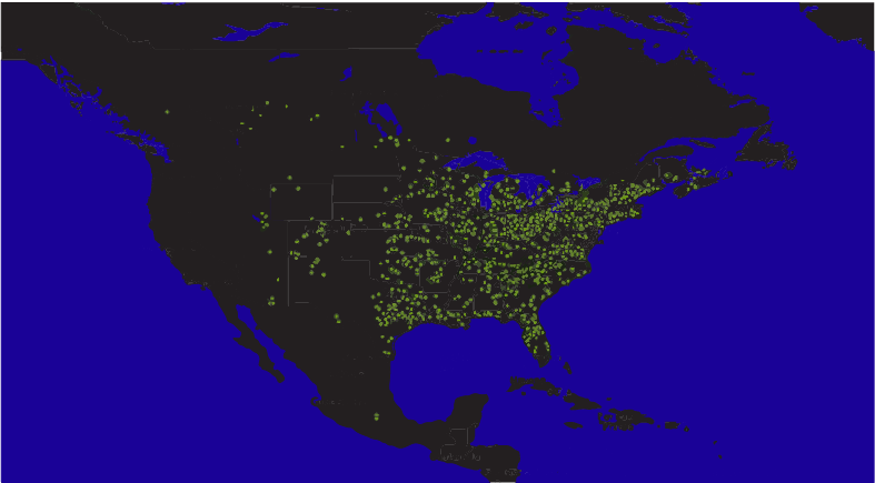 This dark map, with black continents and dark blue water, shows yellow-green pinpricks of light in clusters throughout North America.